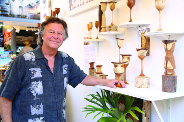 Sullenger at his Sawdust Art Festival booth, where he displays his finished goblets. Photo by  Jody Tiongco.