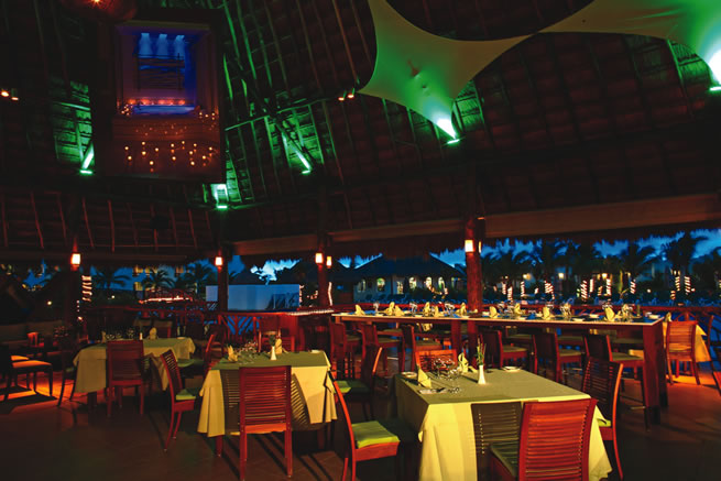 El Dorado Royale, a Spa Resort boasts a culinary theater, where dishes are prepared in open-air kitchens.
