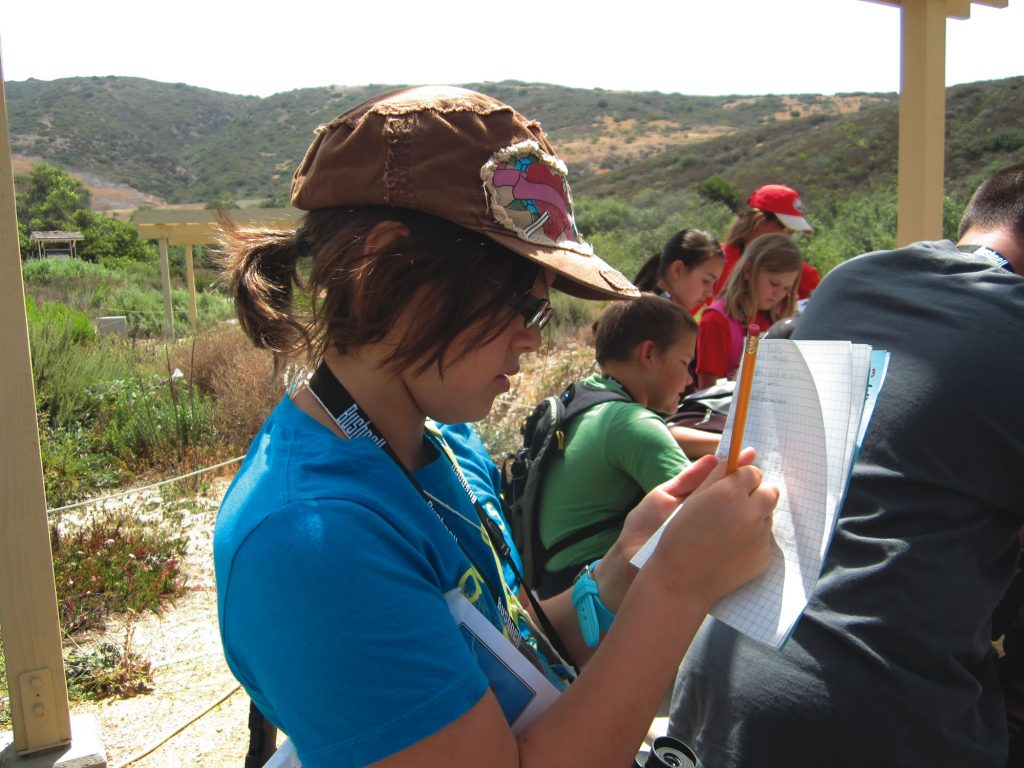 A student logs data as part of a citizen science project.