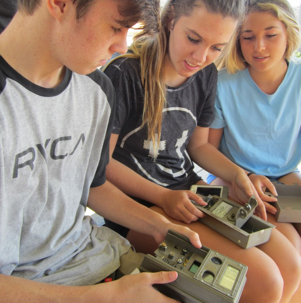 Students prepare their trap cameras for learning about wildlife.