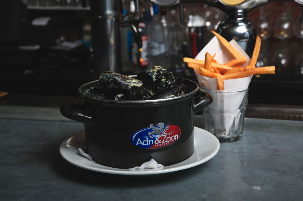 One of Brussels Bistro's most popular dishes is mussels—including this yellow curry variety—and fries.