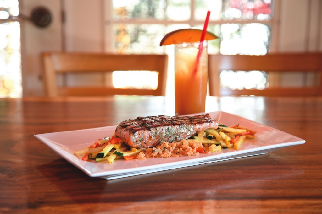 The Jamaican jerk salmon, which is grilled to order, pairs well with Eva's Knockout Rum Punch.