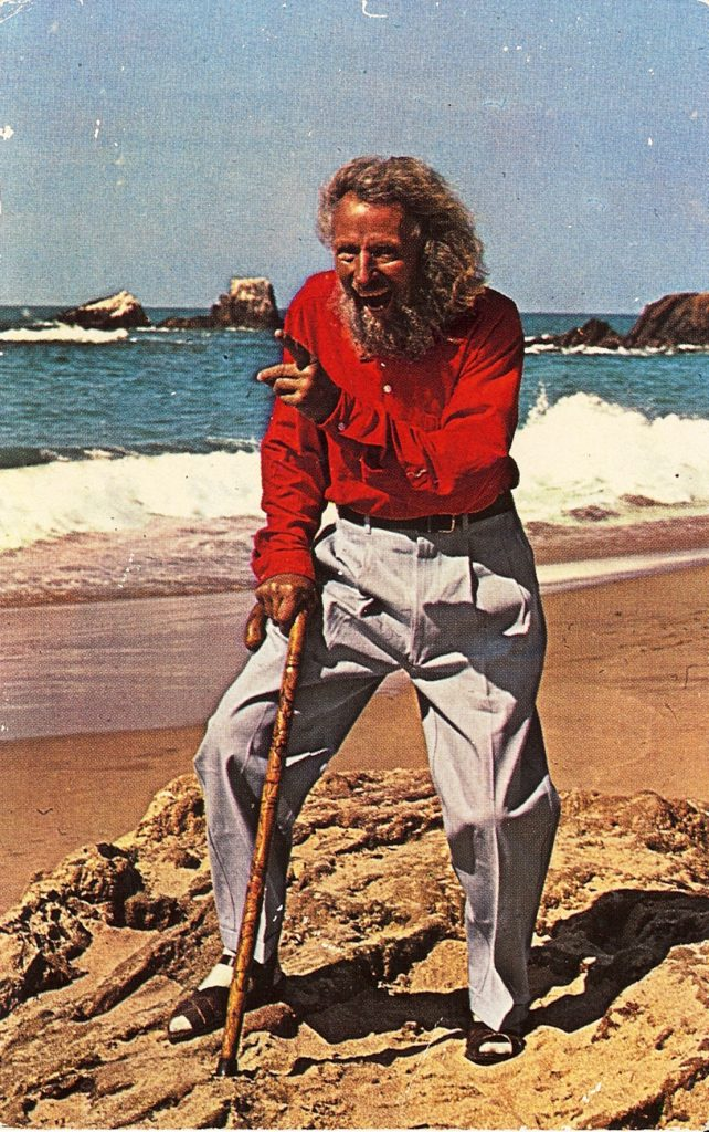 0546 Greeter Eiler Larsen on Beach - Tom Pulley Postcard Collection