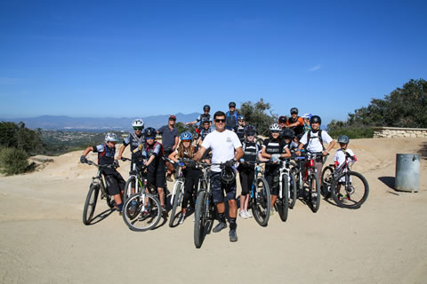 Facundo Malbran (center) is founder of the Laguna Canyon Riders, which bikes together and helps preserve trails.   Photo by Jody Tiongco