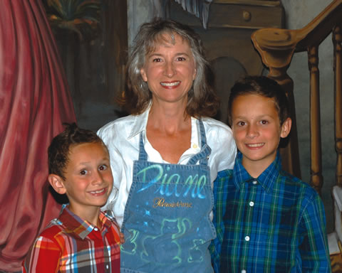 Diane Babcock participates with sons Reidley (left) and Tripton.