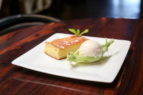 Corn cake is served slightly warm with vanilla bean ice cream.